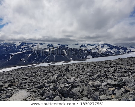 Mountain landscape with a snowfield and moraine Stock photo © Kotenko