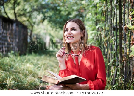 Young woman sitting on fence  stock photo © monkey_business