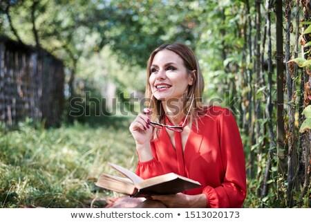 женщину · сидят · забор · улице · улыбающаяся · женщина · улыбаясь - Сток-фото © monkey_business