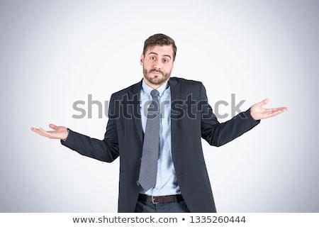verward · kaukasisch · zakenman · schouders · jonge · twijfelachtig - stockfoto © rastudio