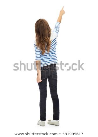 Lány mutat ujj valami láthatatlan oktatás Stock fotó © dolgachov