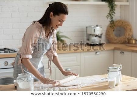 Boldog hölgy pék áll tart kenyér Stock fotó © deandrobot