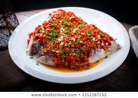 Steamed Fish head with diced hot red peppers Stock photo © raywoo