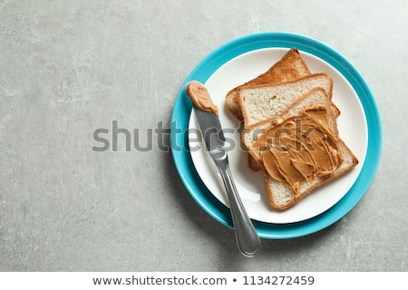 Peanut Butter on Bread with Peanuts stock photo © klsbear