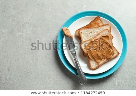 Peanut Butter on Bread with Peanuts Stock photo © klsbear