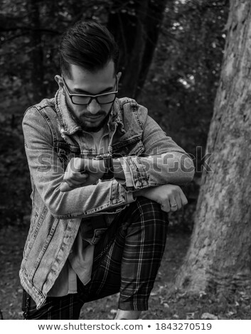 caucasian man wearing glasses showing his watch stock photo © deandrobot