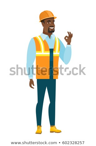 African-american smiling builder showing ok sign. Stock photo © RAStudio