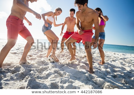 Young man with football on beach Stock photo © IS2
