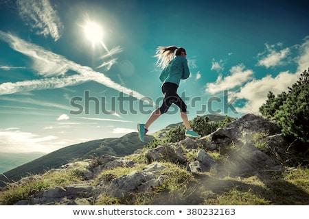 vrouw · lopen · bergen · zomer · zonsondergang · jonge · vrouw - stockfoto © blasbike