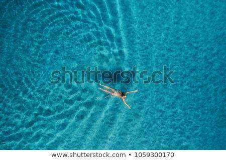 Luchtfoto vrouw zwemmen zee slank roze Stockfoto © denbelitsky