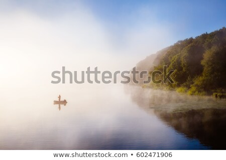vivid view of the foggy pond in morning location place ternopil stock photo © leonidtit