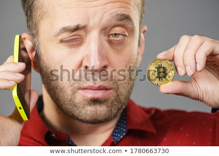 Man holding a Bitcoin BTC in his hand Stock photo © lovleah