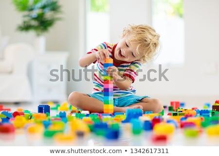 Fiú játék tömbházak jókedv mosolyog áll Stock fotó © IS2