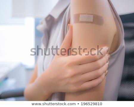 Gips vrouwelijke arm zelfklevend zwachtel Blauw Stockfoto © CsDeli