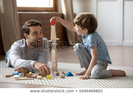 Iki erkek oynama yapı blokları ahşap büro Stok fotoğraf © IS2