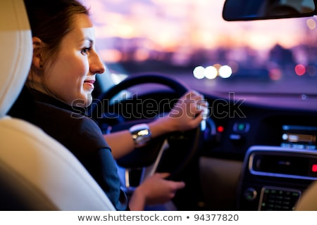 driving a car at night   pretty young woman driving her modern stock photo © lightpoet
