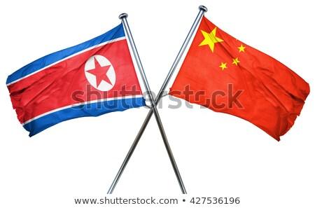 Two waving flags of North Korea and China Stock photo © MikhailMishchenko