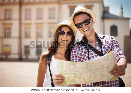Couple looking at a map, laughing Stock photo © IS2