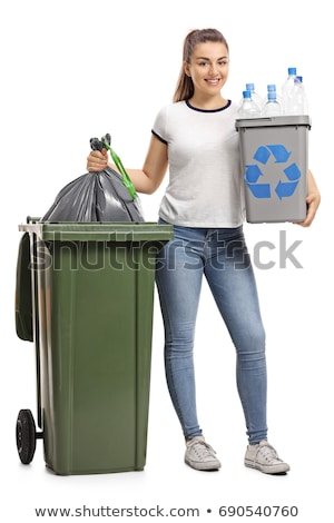 Young girl with can next to bin Stock photo © IS2