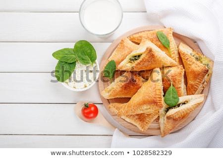 finom · sütemény · mazsola · fehér · fa · asztal · tekercsek - stock fotó © melnyk