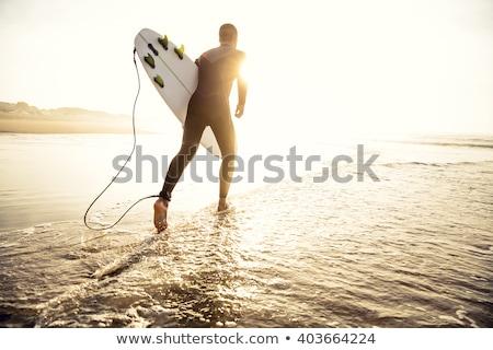 Surfer esecuzione tavola da surf uomo Ocean spiaggia Foto d'archivio © joyr