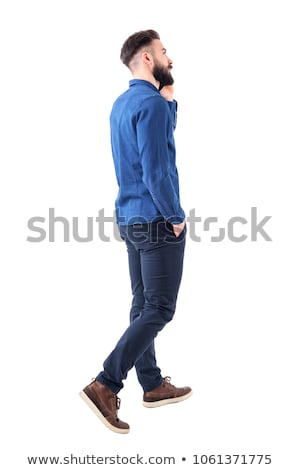 rear view of relaxed man walking and looking to side Stock photo © feedough