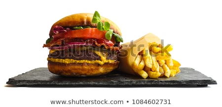 Fried meat and potatoes on paper Stock photo © dash