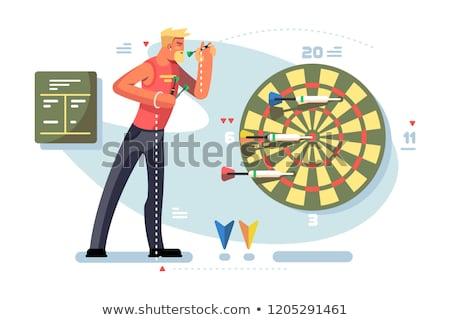 Człowiek gry rzutki gry mistrzostwo sportowiec Zdjęcia stock © jossdiim