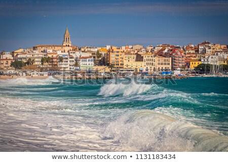 Beautiful Spanish village Palamos in Costa Brava with big waves Stock photo © digoarpi