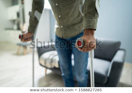 Mozgássérült férfi mankók sétál padló televízió Stock fotó © AndreyPopov