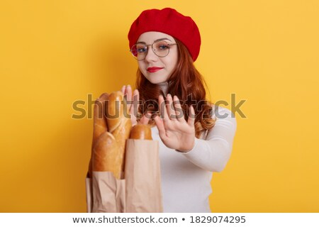Woman Refusing Bread Offered By Person Stock photo © AndreyPopov