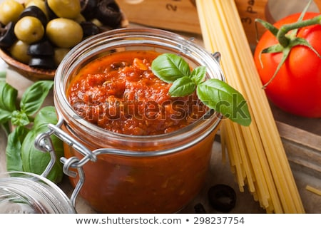 glass jar with homemade classic spicy tomato pasta or pizza sauce stock photo © melnyk