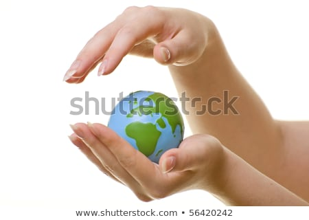 Stock photo: close up of female hands holding green globe