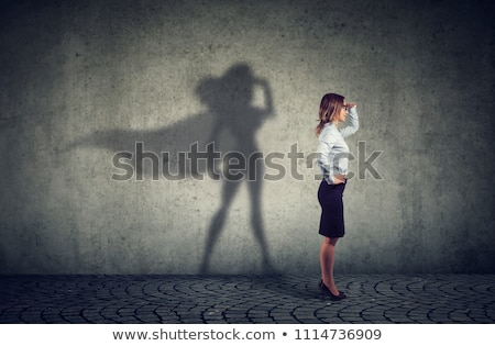 Side view of a woman imagining to be a super hero looking aspired. Stock photo © ichiosea