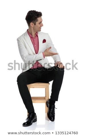 positive modern seated man agrees with someone next to him  Stock photo © feedough