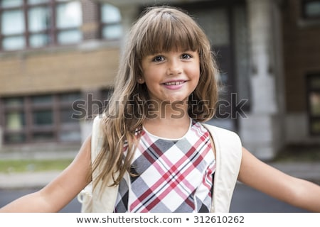eight years old school girl close to the schoolyards Stock photo © Lopolo