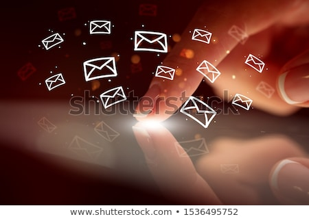 Finger touching tablet with hologram app icons above Stock photo © ra2studio