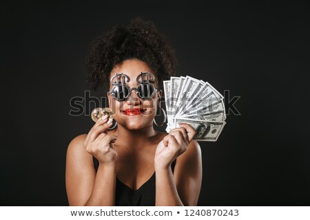 Image of fancy afro american woman wearing dollar glasses holdin Stock photo © deandrobot
