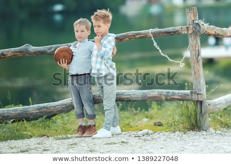 A Boys Stand near Wooden Fence in a willage Stock photo © ElenaBatkova