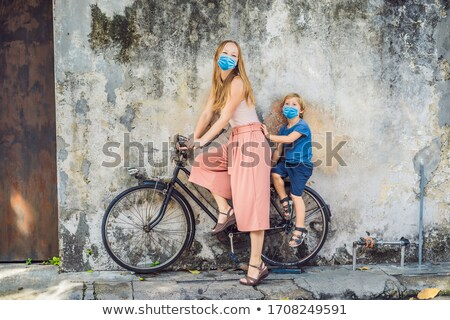 Mother and son on a bicycle. Public street bicycle in Georgetown, Penang, Malaysia Stock photo © galitskaya