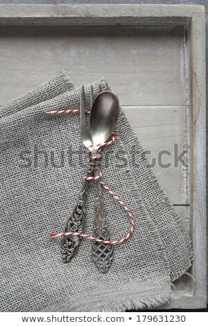 Spoon and fork on sackcloth napkin on wooden tray Stock photo © Melnyk