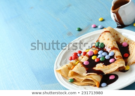 Homemade crepes with multicolored dragee Stock photo © Melnyk