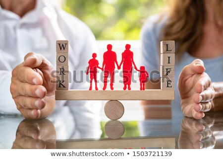 mid section of couple protecting work and life balance on seesaw stock photo © andreypopov