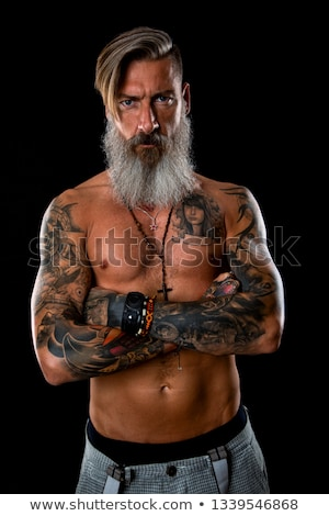 Fashionable shirtless man with tattoo posing in jeans Stock photo © dashapetrenko