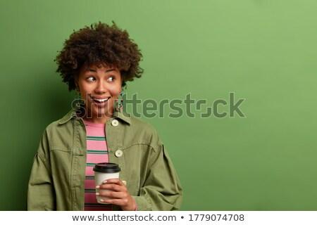 Figyelmes fiatal nő élvezi ital eldobható bögre Stock fotó © Giulio_Fornasar