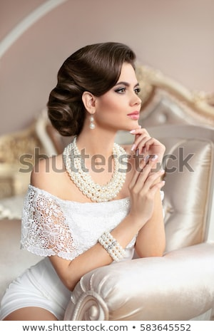 Beautiful woman with Pearl Necklace. Young beauty model with pearl pendant and earrings. Jewellery a Stock photo © serdechny