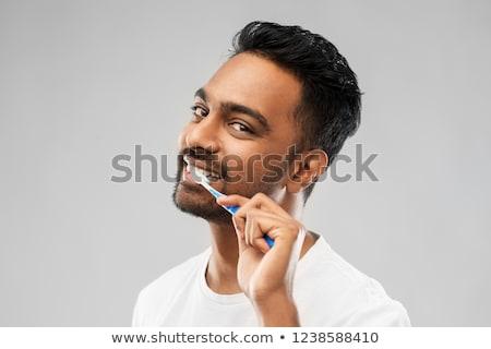 Indiai férfi fogkefe takarítás fogak orális Stock fotó © dolgachov