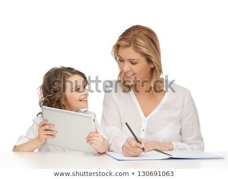Foto stock: Mãe · filha · lição · de · casa · educação · família