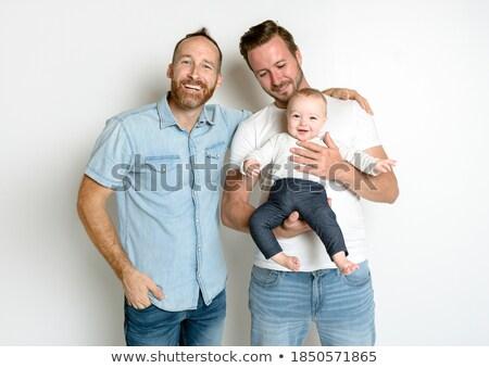 Glücklich Vater halten Baby Tochter Haus Stock foto © dolgachov