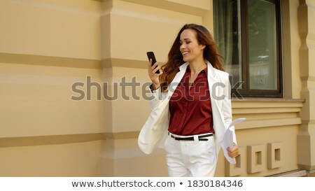 Cheerful woman in the street walking Stock photo © Lopolo